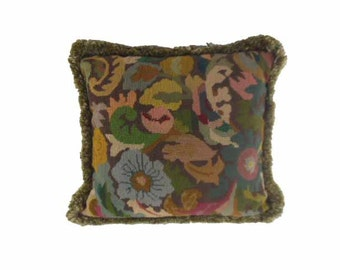 Organic rendering of floral shapes in wool needlepoint from the 1920s.