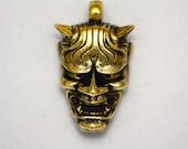 Hannya skull brass pendant