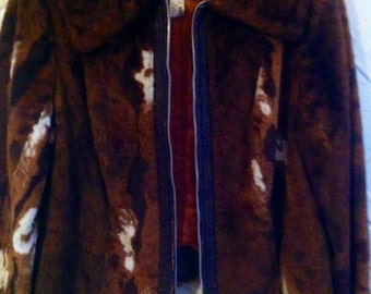The coolest 1970s faux cow hide and faux leather jacket .