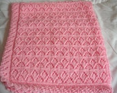 handknitted baby blanket in pink