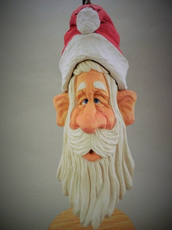 Whimsical hand carved wood santa ornament