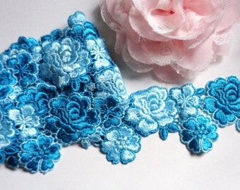 1 1/2 inch wide shade of blue lace trim selling by the yard