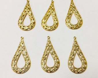 6 gold plated charms
