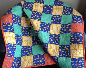 """Brightly Colored Fish, Aqua, Orange and Yellow Altogether In This 40"""" X 40"""" Quilt"""