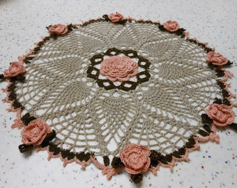 Pineapple doily in shades of brown, tan and flowers made of peach
