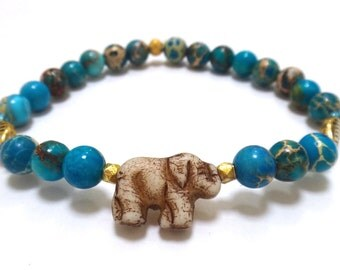 Turquoise Magnesite Beaded Bracelet with Elephant Charm, Gold Leaf Charms and Blue/Gold Spacers