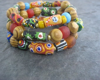 African trade bead bracelet set with multi-colored handmade Ghana glass beads, Padre and Olive wood beads, and gold plated glass spacers