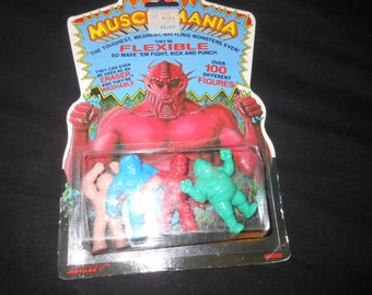 moc MUSCLEMANIA wrestling stretch figures - M.U.S.C.L.E. - 80s pvc wwf eraser