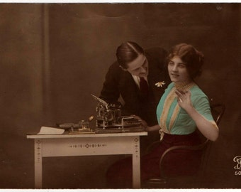 Postcard of Ideal Hammond Ambassador Typewriter with Pretty Girl