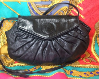 70's, 80's vintage FENDI black nappa leather oval round shape shoulder purse. Can be a clutch bag as well.