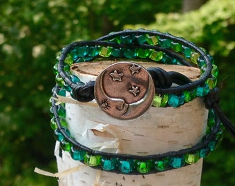 Black Leather Wrap Bracelet made with shades of blue & green glass beads.