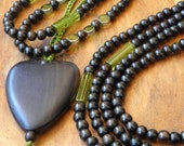 218 - Set of 3 long necklaces wooden pearls of ebony darkened and glass pearls lined, with silverwhich you can wear together or separately.