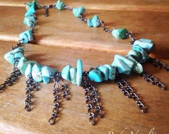 Turquoise chip me klave with fringe chain