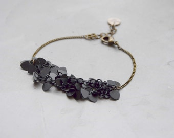 Bracelet black pendants on chain bronze