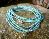 Multi layered handmade wrap bracelet/necklace with montana blue, turquoise lined seed beads and thai silver beads
