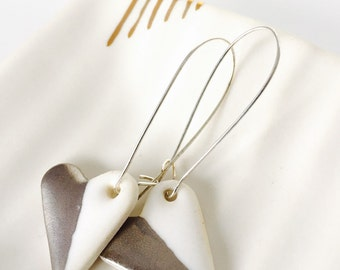 Porcelain earrings with platinum lustre.