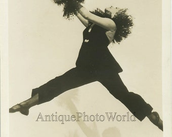 Jumping woman dancer in Art Deco costume antique photo