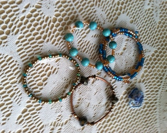 Beautiful Set Of Four Handmade Beaded Stretch Bracelets.