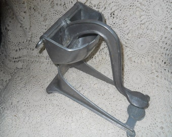 Ware ever metal juicer from 1940s
