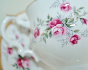 Queens teacup and saucer with detailed small pink English roses