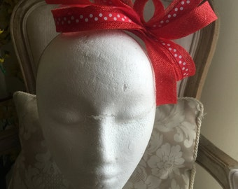 Sophisticated red fascinator loop with feathers on a silver headband!