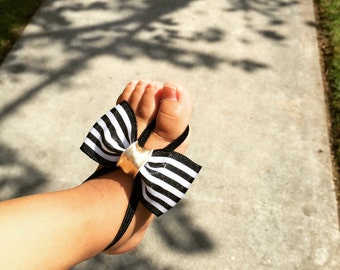 Black and white bow barefoot sandals
