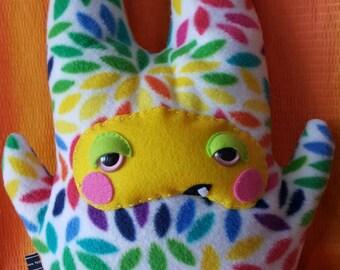 Sleepy rainbow monster plushie