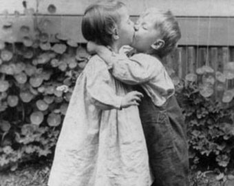 Young Children Kissing Photograph (Art Prints available in multiple sizes)
