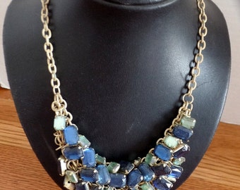 Vintage statement necklace from the 50s or 60s.  It is built over a chain linked base.