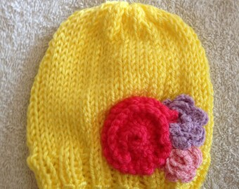 Baby hat with flower accent