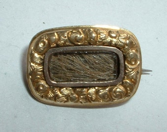 Small Victorian mourning brooch with lock of hair