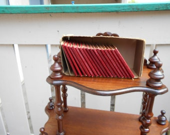 Sixteen Little Red Leather Library books