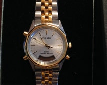 New mens two tone yellow and silver Pulsar watch with silver and gold metal band and face