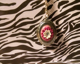 Pink and white flower locket