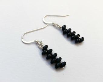 Dainty black zig zag sterling silver earrings with glossy black glass beads. Dangle earrings from UK seller. Unusual earrings
