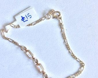Silver bracelet with trio of white stones