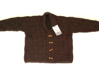 This is a Jacket knitted in a woollen mixture yarn and is machine washable at 40 degrees.