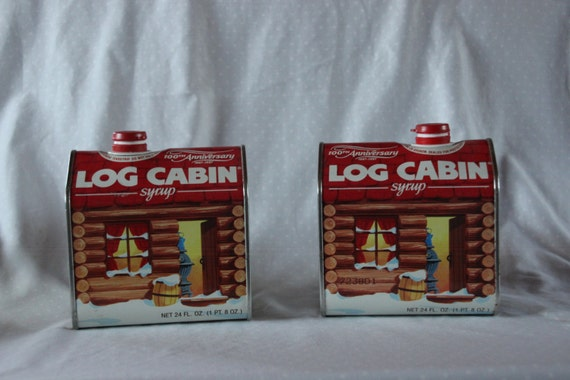 Pair of log cabin syrup th anniversary tins