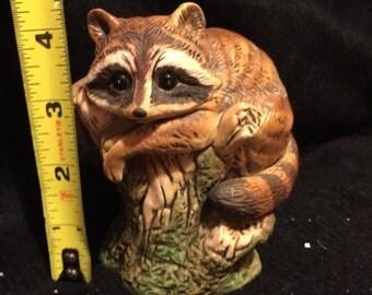 Enesco racoon figurine numbered on bottom.
