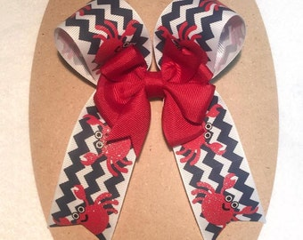 Nautical Crabs Cheerleader Boutique Hair Bow on Partially Lined Clip- 5 inches by 6 inches - red, blue, red center pinwheel - long tails