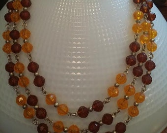 Orange and brown three strand necklace