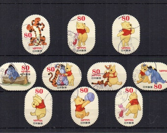 Japanese Winnie the Pooh small postage stamps. Japan cartoon children's book crafts collecting scrapbooking decoupage, party invites.