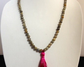 Grey beaded necklace with pink tassel
