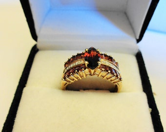 Garnet Ring.  Natural Garnet Marquise & Diamonds in a Yellow Gold Ring.