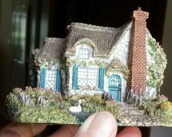 """Thomas Kinkade """"Swanbrooke Cottage""""  Cottage Resin Figurine"""