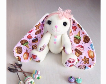 The handmade hare (rabbit) toy with confection on the ears. Cotton and polar with hollowfiber inside.