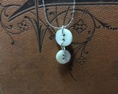 Two tiny mother of pearl buttons necklace