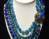 Vintage SELINI blue bead six strand Necklace with ornate clasp