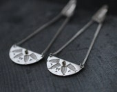 Cleopatra Returns long silver earrings with dot of 14kt gold