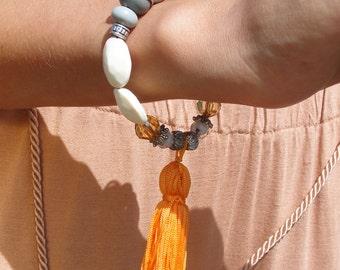 Unique upcycled 70's vintage beaded bracelet in cream grey & orange tassel charm bracelet FESTIVAL